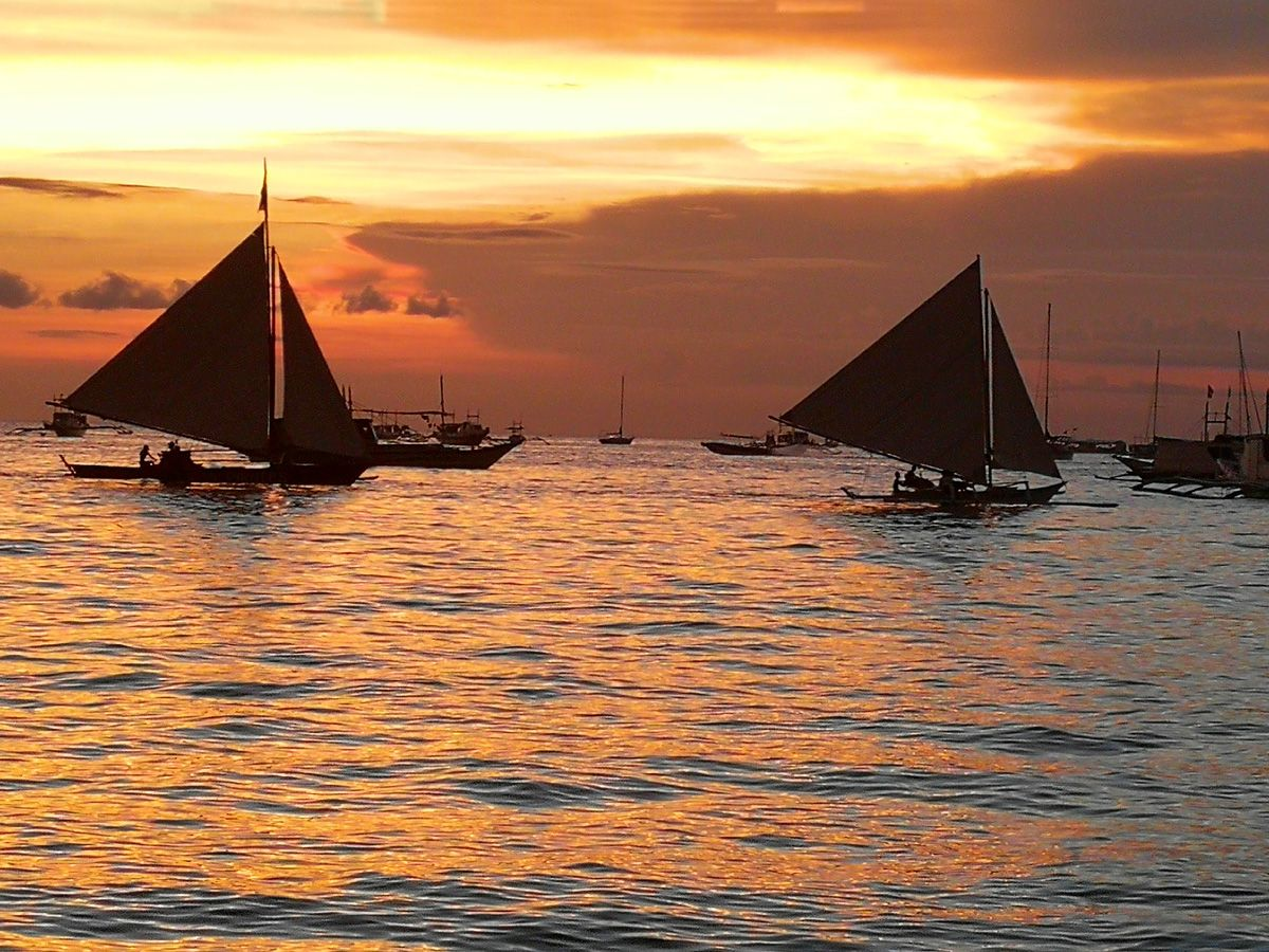 Paraw sunset sailing in boracay photo