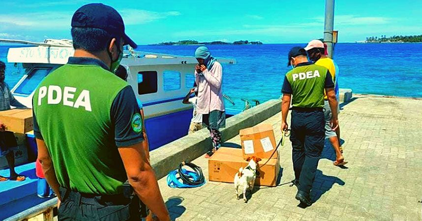 A PDEA agent lets a K9 do the job of sniffing out possible illegal drugs from inside cargo offloaded at the ports./iNEWS